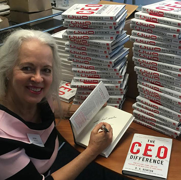 Signing a few of her books