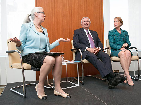 Debra moderating a panel with Stern and Fiorina