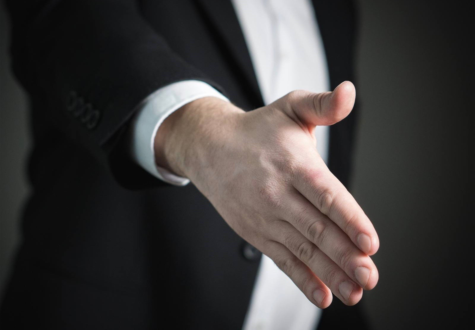 Man holding hand out for handshake