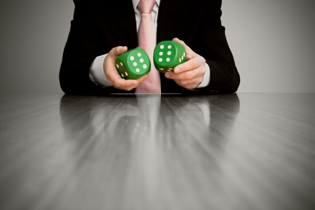Businessman Holding Two Green Dice