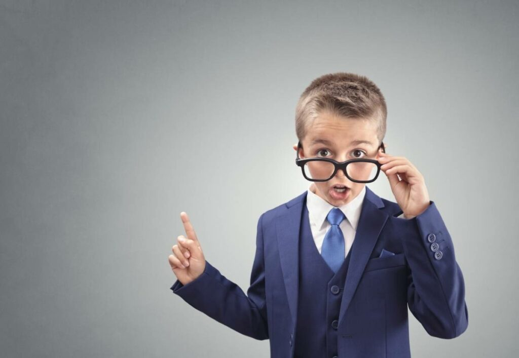 Boy in Business Suit Making a Surprised Face