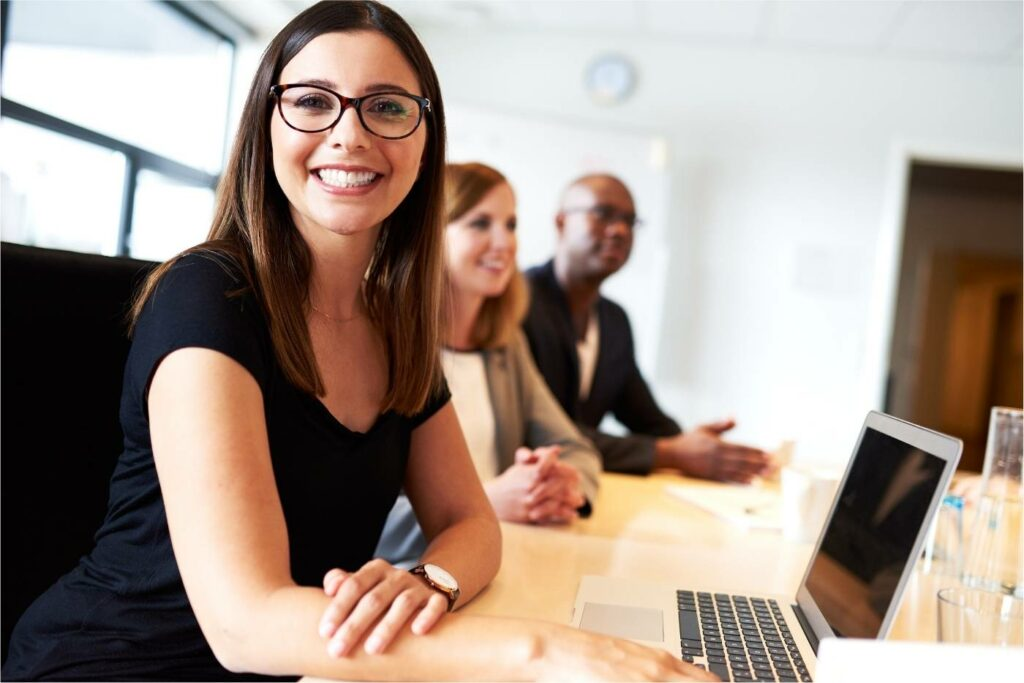 Woman In Meeting Smiling Confidently