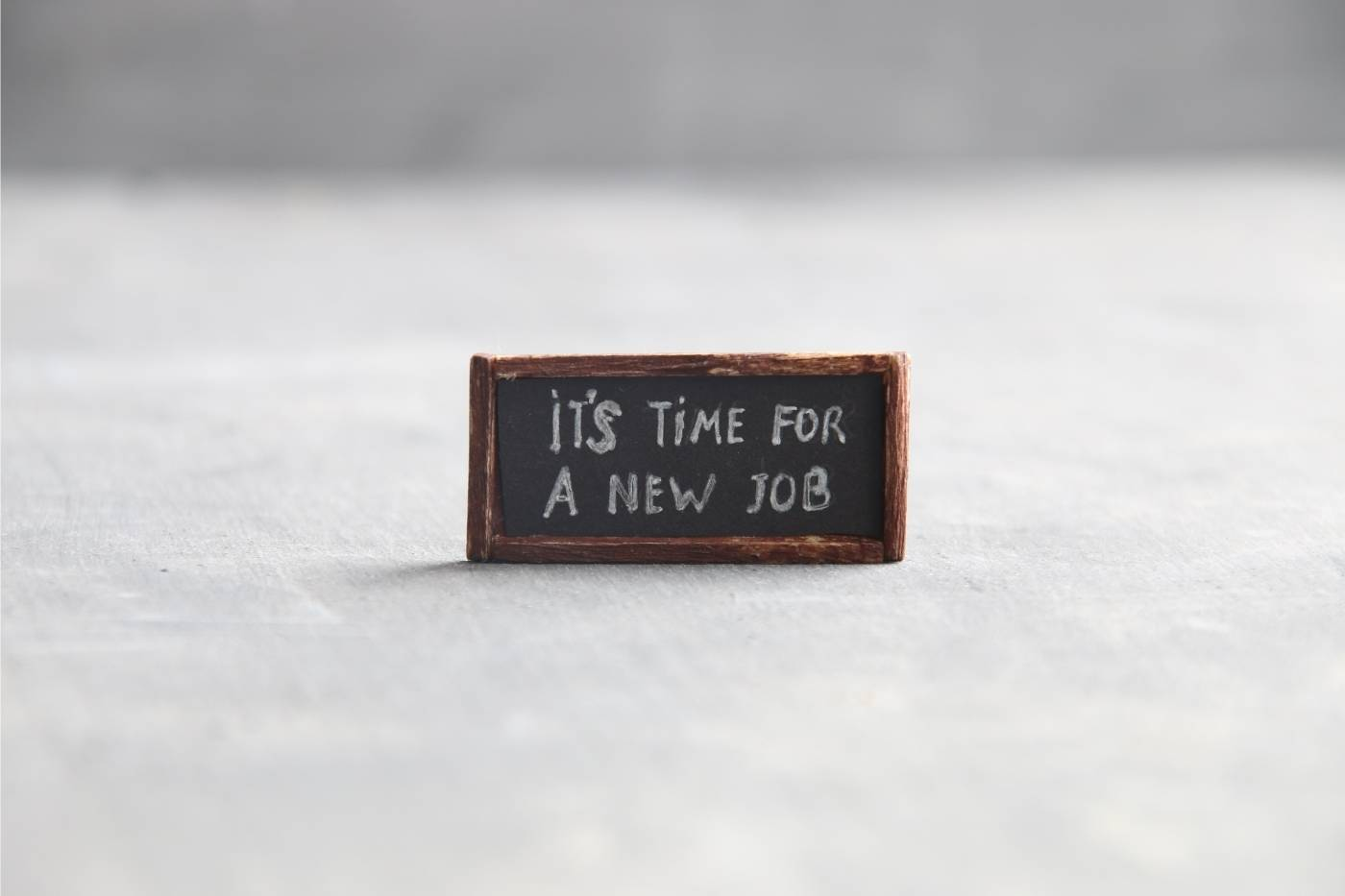"Small chalkboard sign that say ""It's Time For A New Job"""