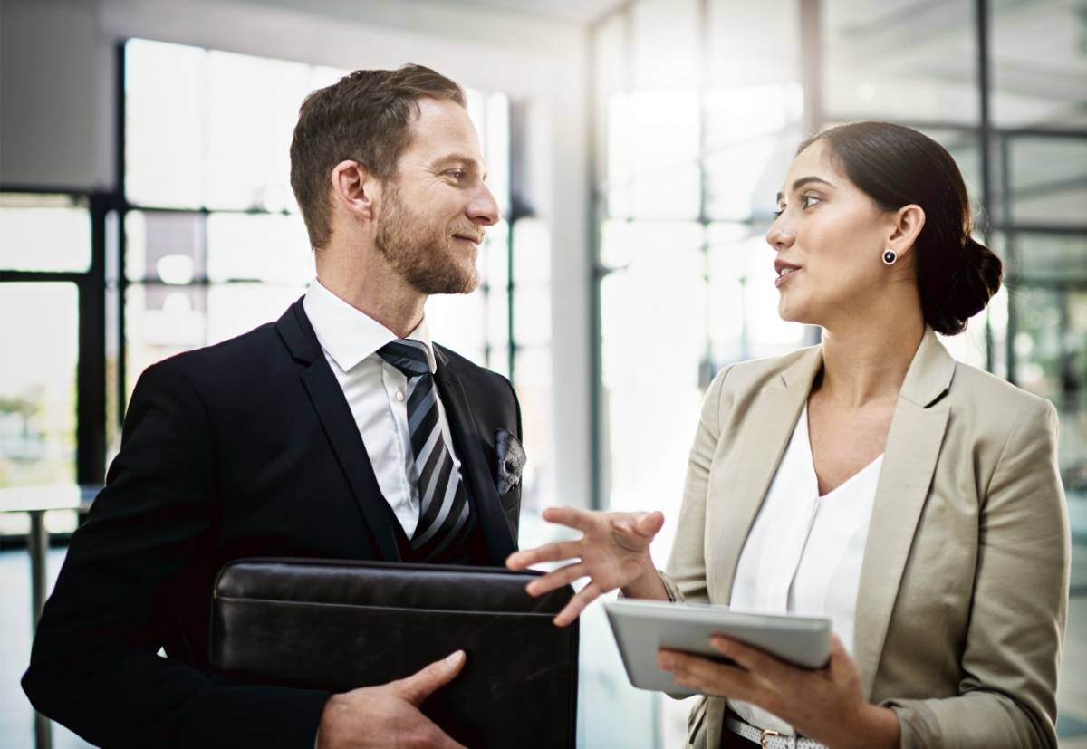 Female Boss Giving Constructive Feedback to Male Employee