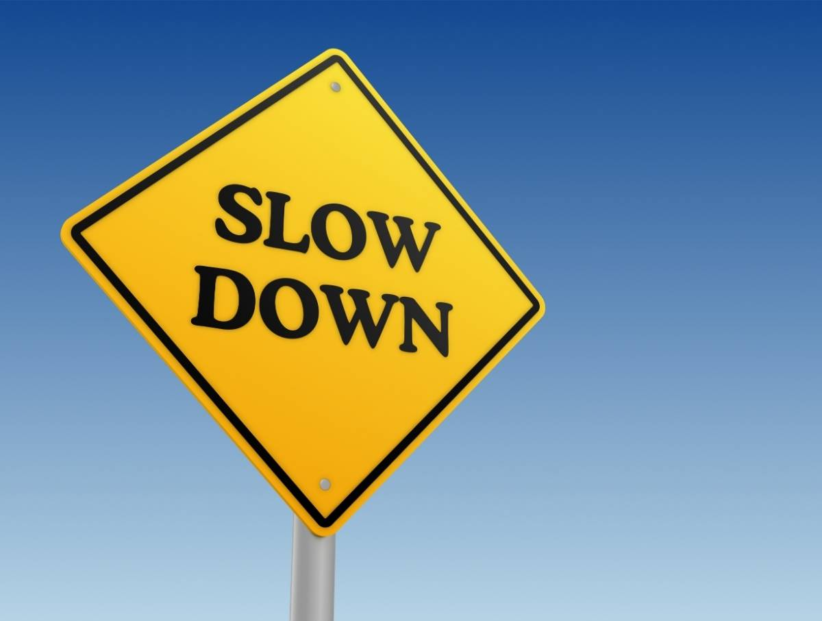"Sign That Says ""Slow Down"" To Help You Improve Effectiveness At Work"