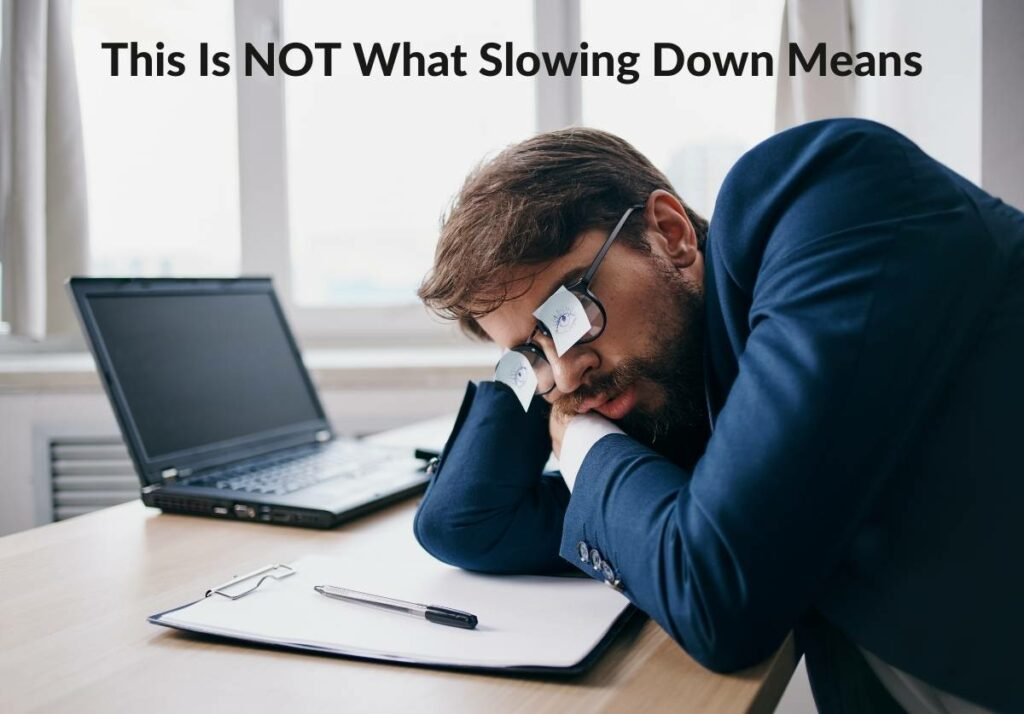 """Man Sleeping At Desk with caption that reads """"This Is NOT What Slowing Down Is"""""""