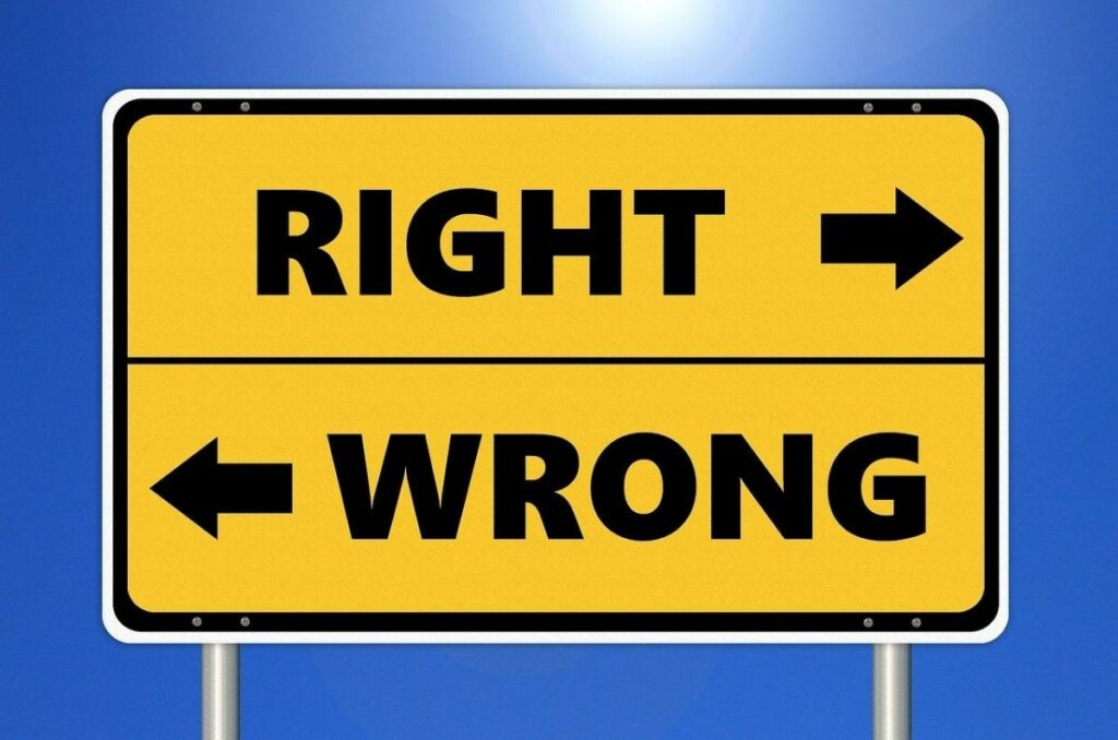 """Sign that says """"Right"""" with an arrow to the right and """"Wrong"""" with an arrow to the left"""